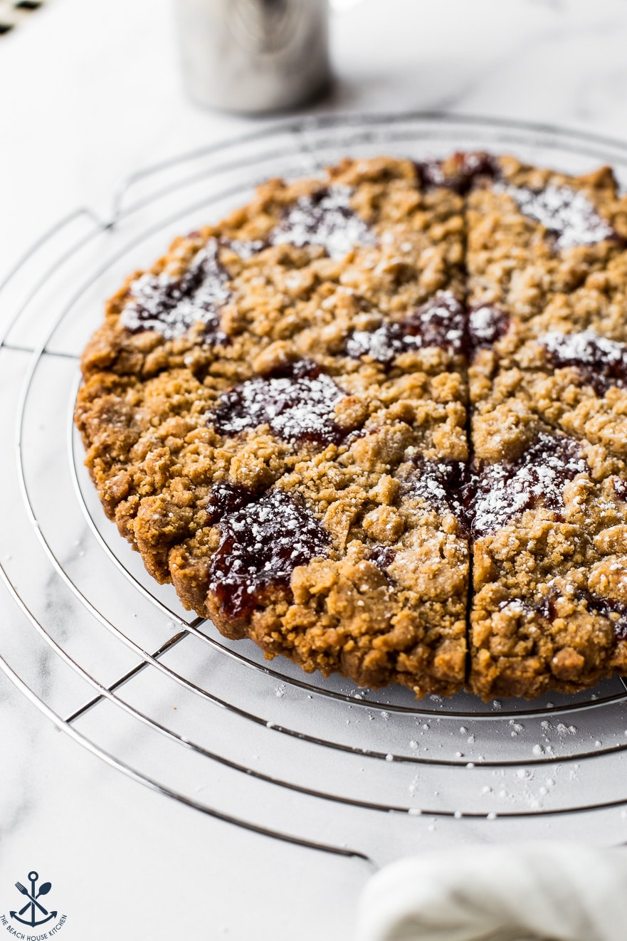 Strawberry Jam Crumb Cookies on a round wire rack