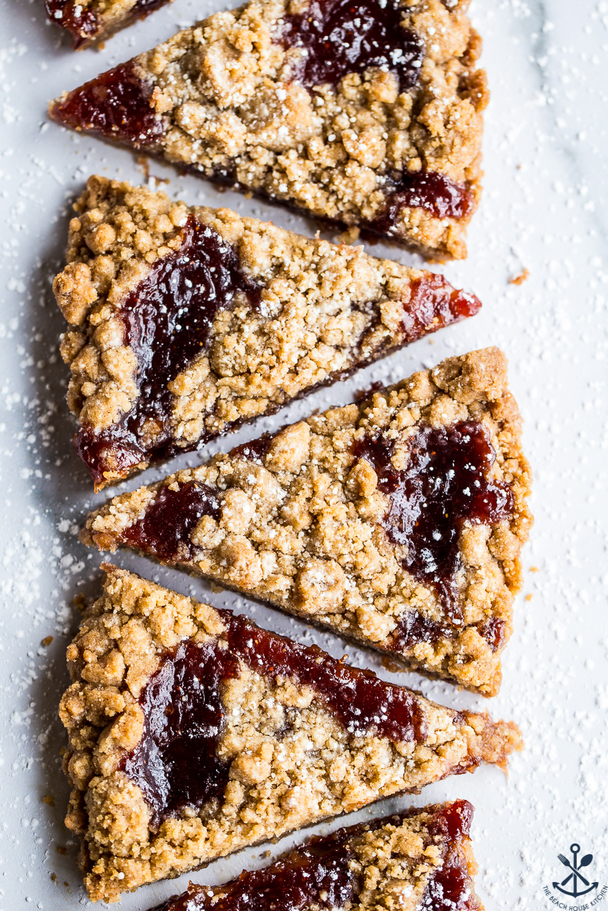 Wedges of jam crumb cookies in a row