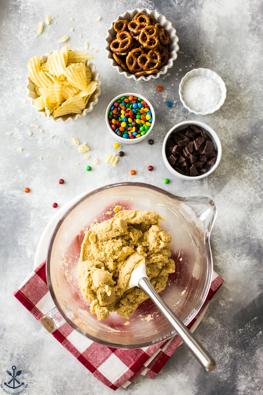 Overhead photo of ingredients for cookies in bowls on top of a greyish surface