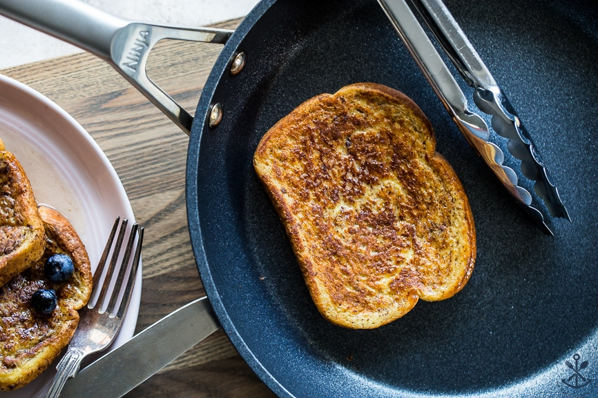 Overhead photo of a slice of french toast in a skillet
