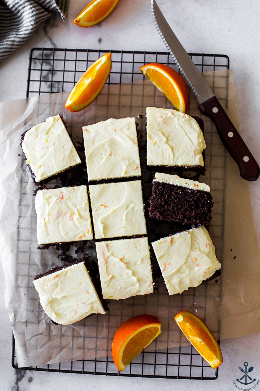 Overhead photo of chocolate cake slices with orange buttercream