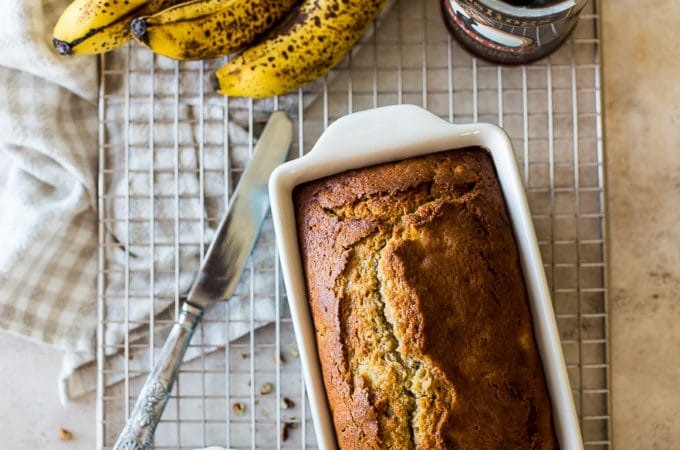 Overhead photo of Boozy Banana Bread in a loaf pan on a wire rack