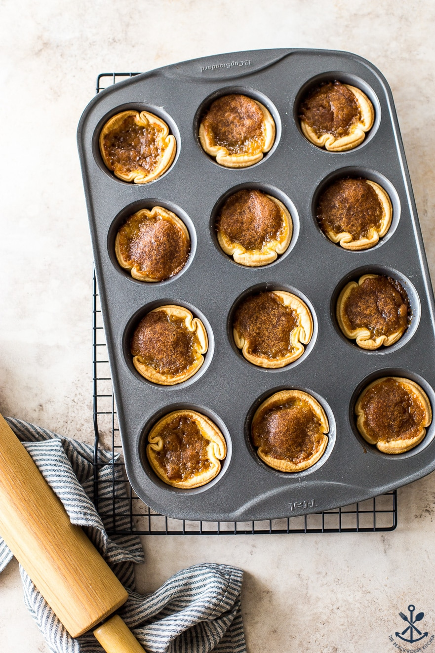 Overhead photo of a muffin tin filled with butter tarts