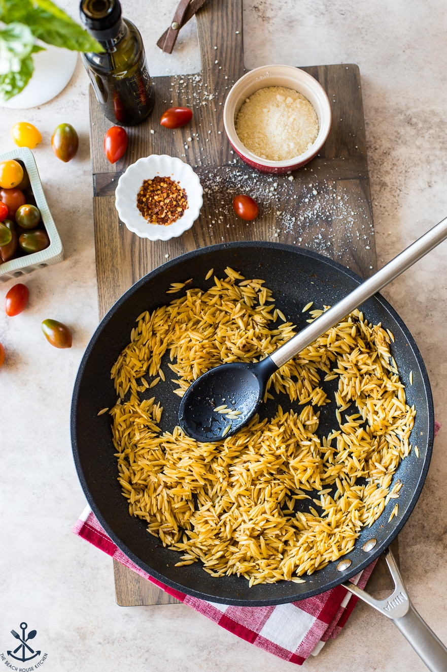 Overhead photo of skillet filled with cooked orzo