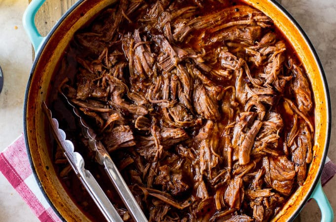Overhead photo Beer-Braised BBQ Chuck Roast in a Dutch oven