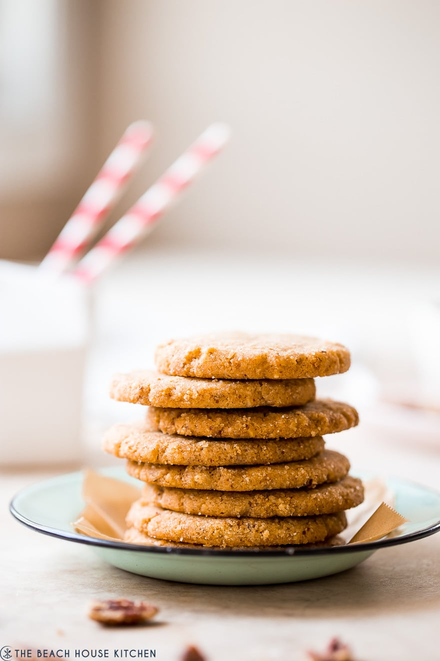 A stack of pecan sandie cookies on a plate