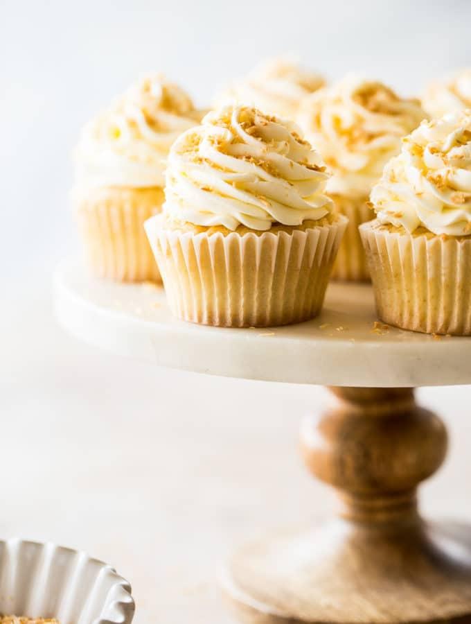 Pina Colada Cupcakes on a cake stand