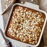 Pverhead photo of Easy Spiced Honey Snack Cake in a square baking dish