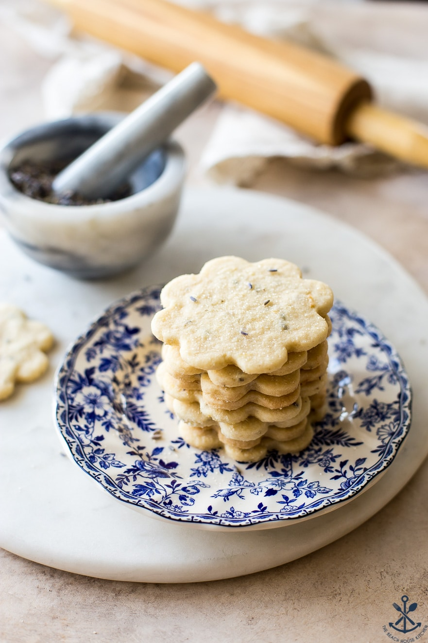 Up close photo of lemon lavender cookies on a blue and white plate