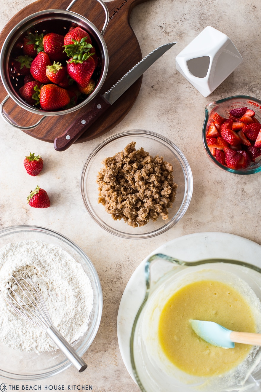Overhead photo of ingredients in bowls for strawberry buckle