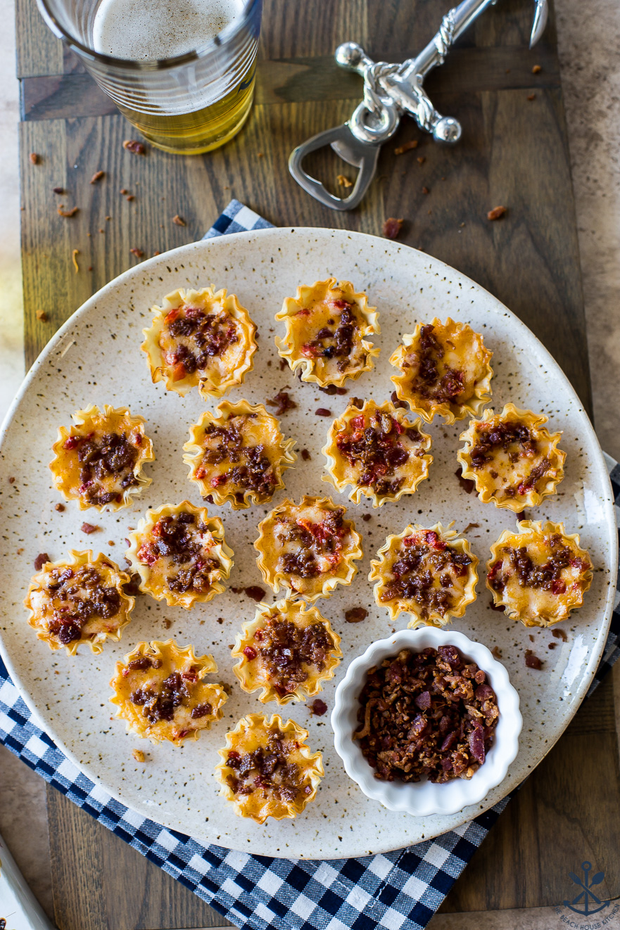 Overhead photo of phyllo tarts filled with pimento cheese and topped with bacon