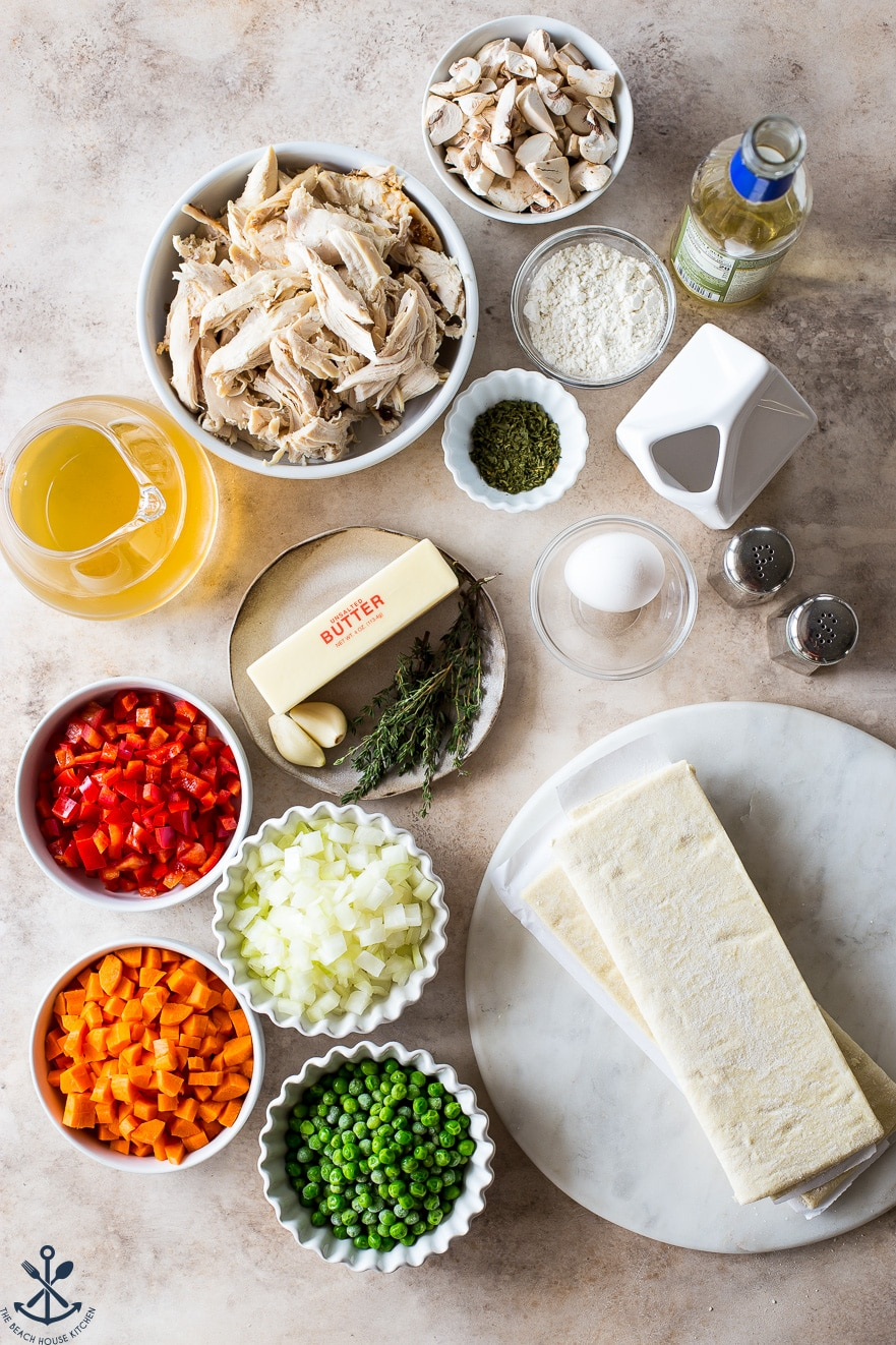 Overhead photo of ingredients for chicken pot pies in bowls