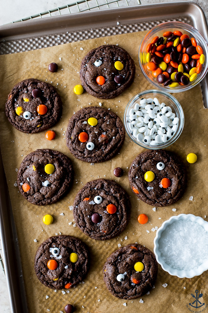 Overhead photo of a baking sheet with chocolate Reese's Pieces Cookies