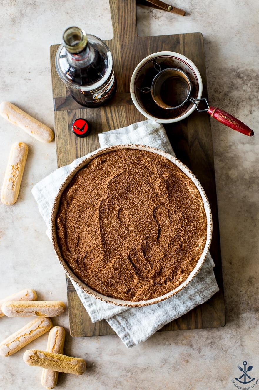 Overhead photo of a round dish of cocoa dusted tiramisu